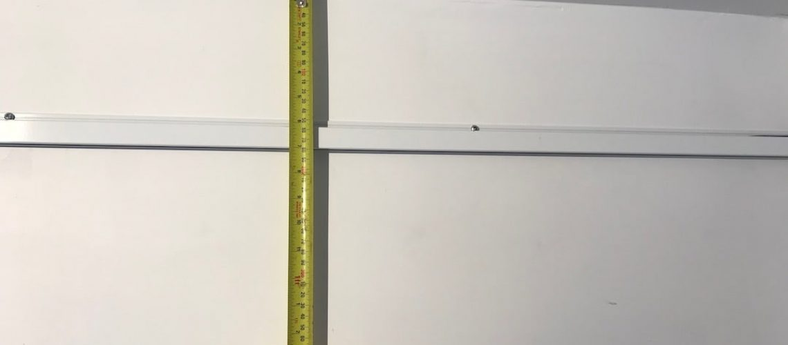At what height should I install my picture hanging system?